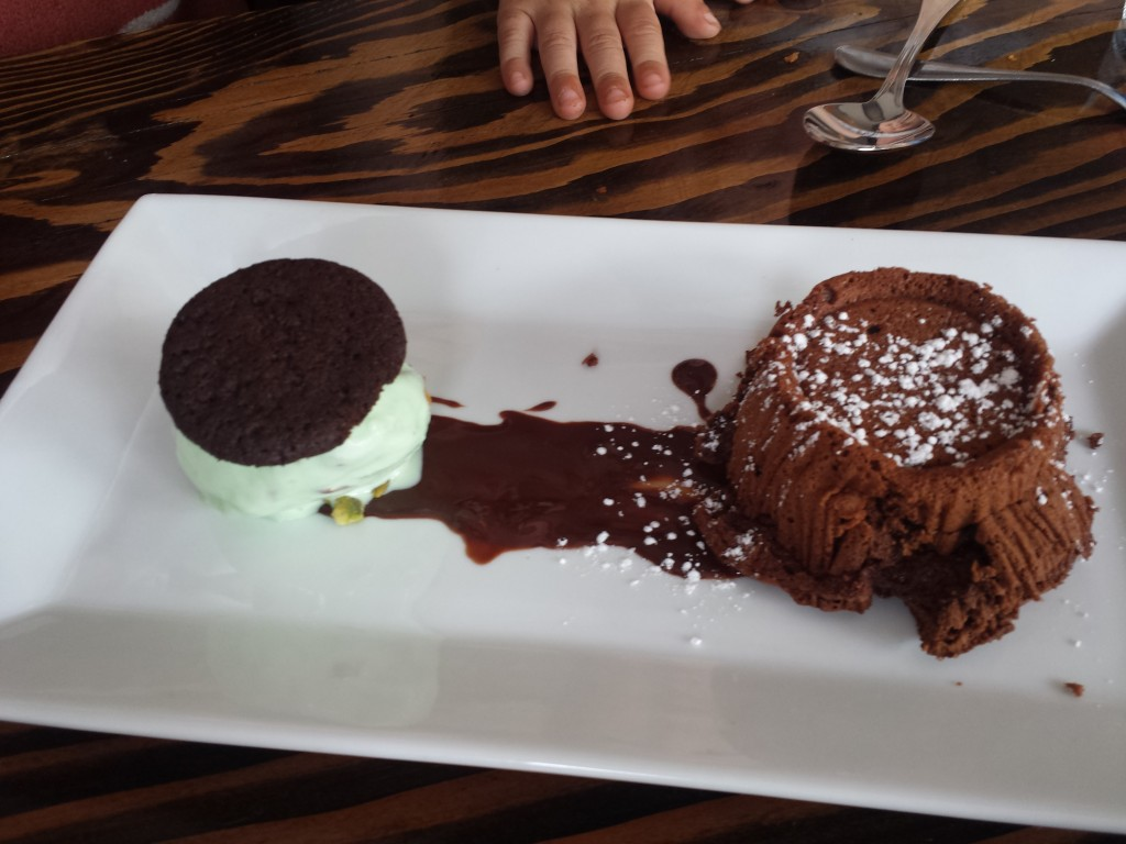 Chocolate souffle with pistachio ice cream